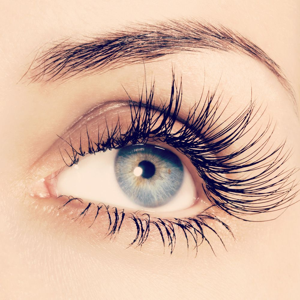 Close-up of woman's eye with long eyelashes