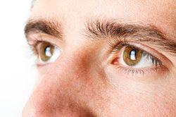 Close up of man's brown eyes