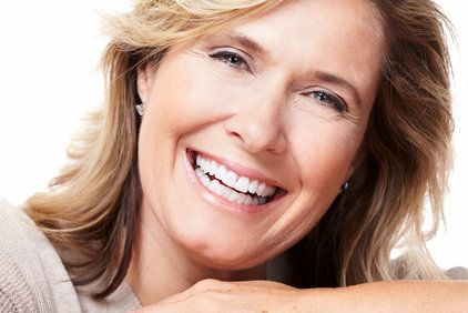 Close up, middle-aged blonde woman smiling after face lift