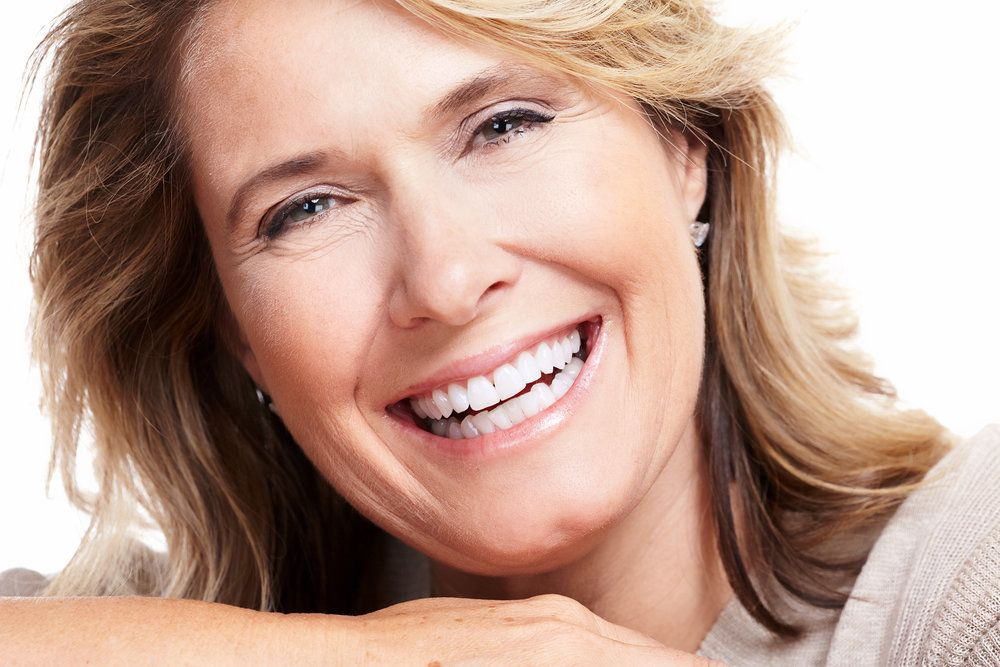 Smiling senior woman with a smooth brow