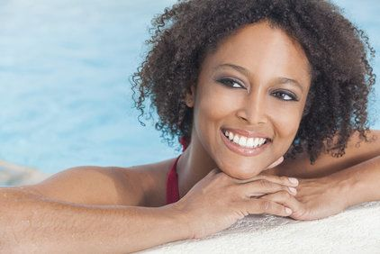 Smiling woman on the side of a pool