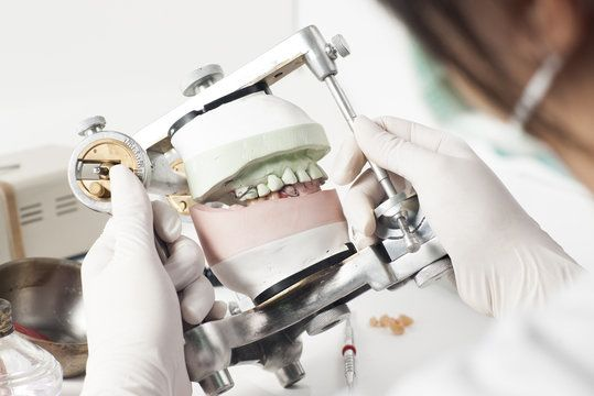 Lab technician creating dental mock-up