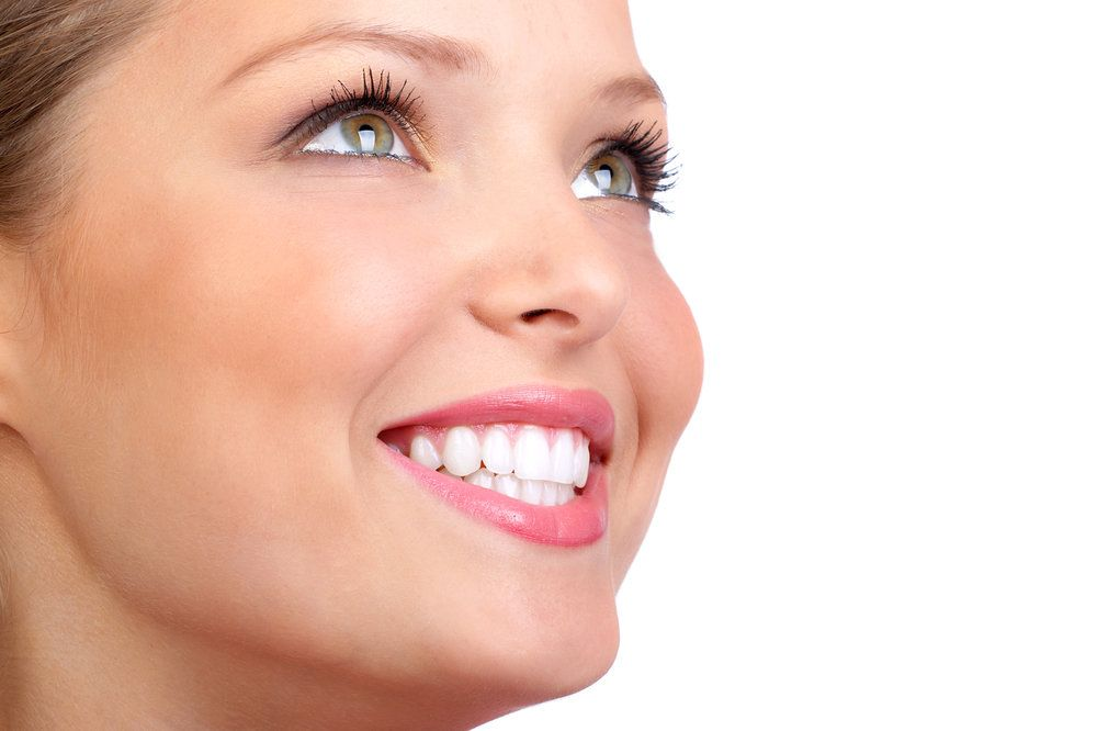 Smiling woman looking upwards