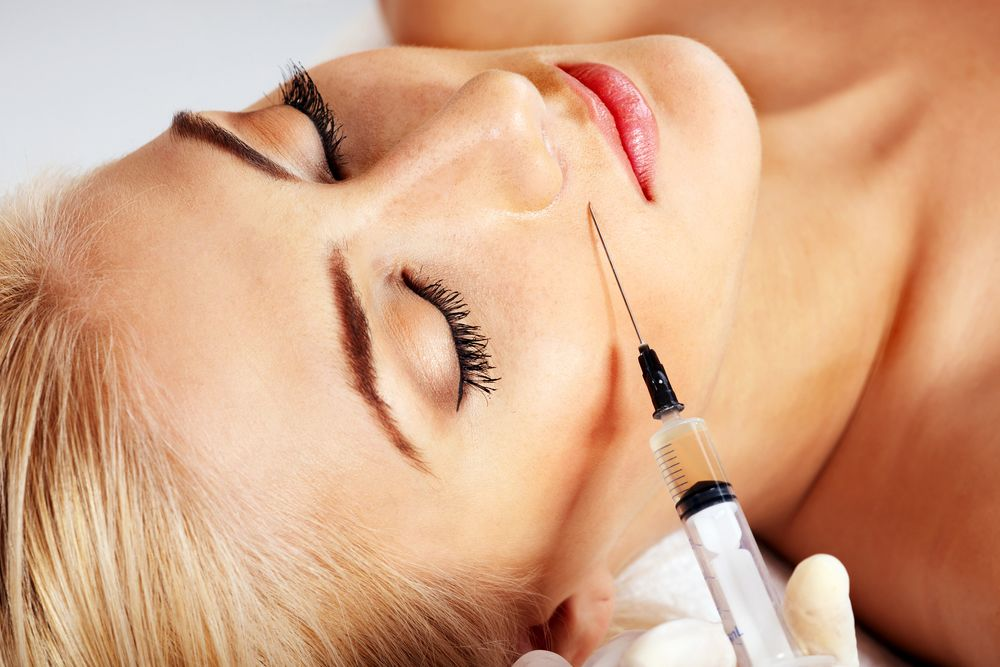 A woman undergoing dermal filler injections