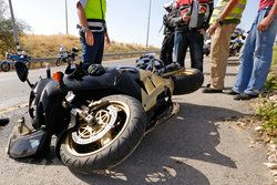 Men surveying motorcycle crash