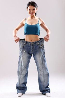 A woman who has lost weight in very large pants