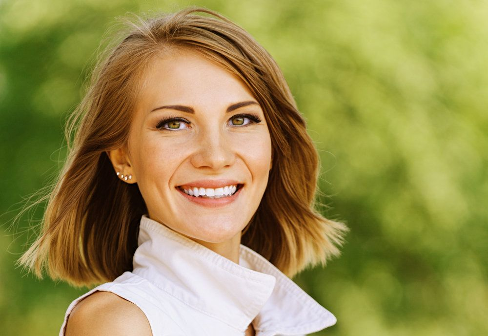 A woman outdoors smiling