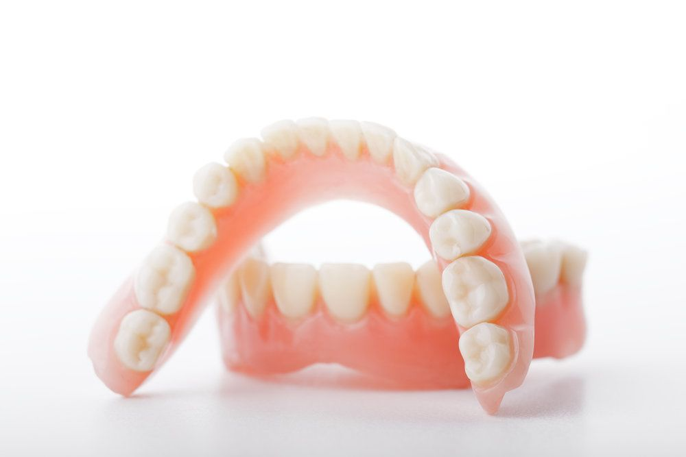 A pair of full dentures