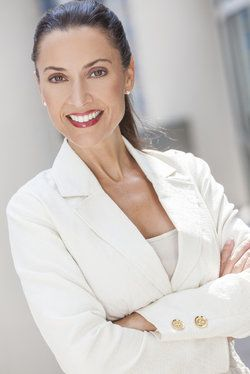 Smiling middle-aged woman in white blazer
