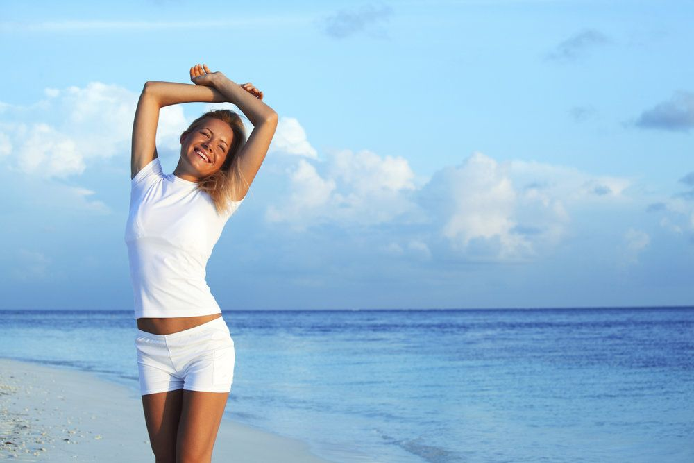Woman with a healthy body on the beach