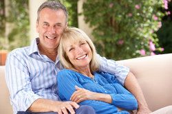 Older couple with healthy, attractive smiles