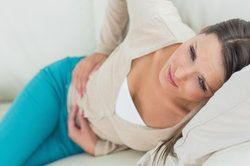 woman holding abdomen in pain