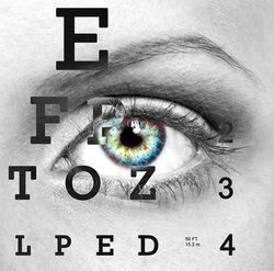 An eye chart and a patient's eye