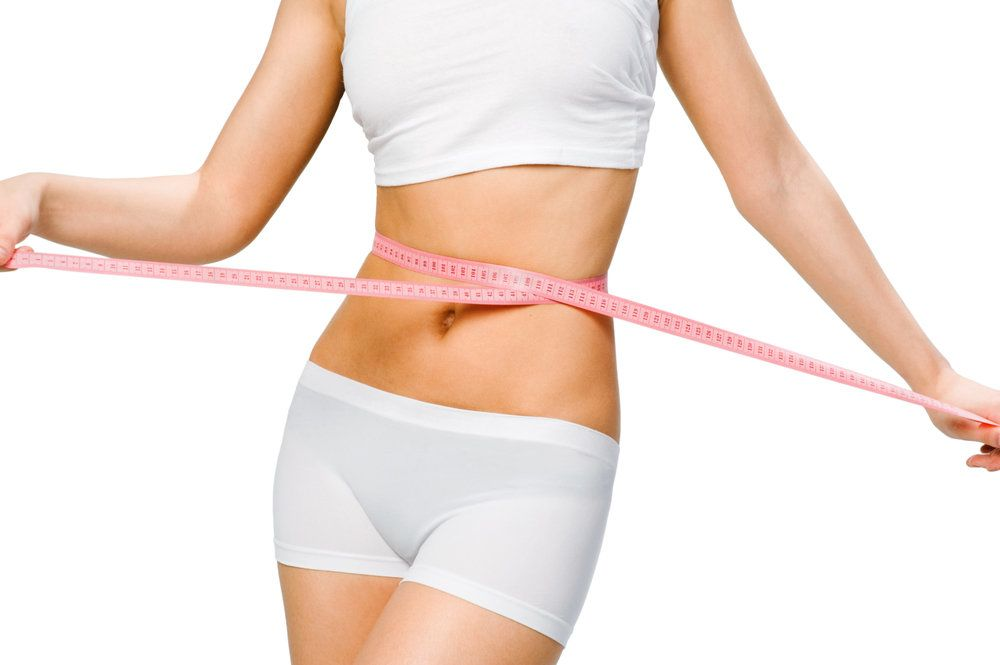 A woman with a measuring tape around her waist