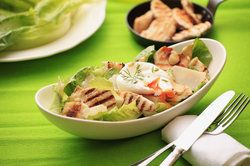 Healthy meal featuring salad and chicken breast