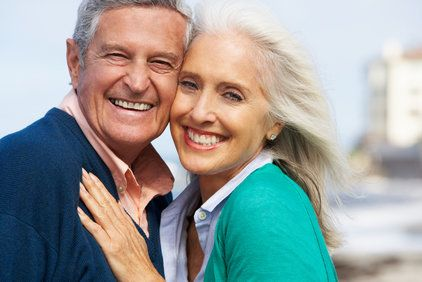 Happy-looking older couple in bright colors