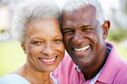 Smiling senior couple posing with heads together