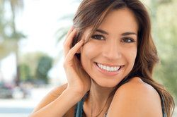 Attractive smiling brunette with straight, white teeth