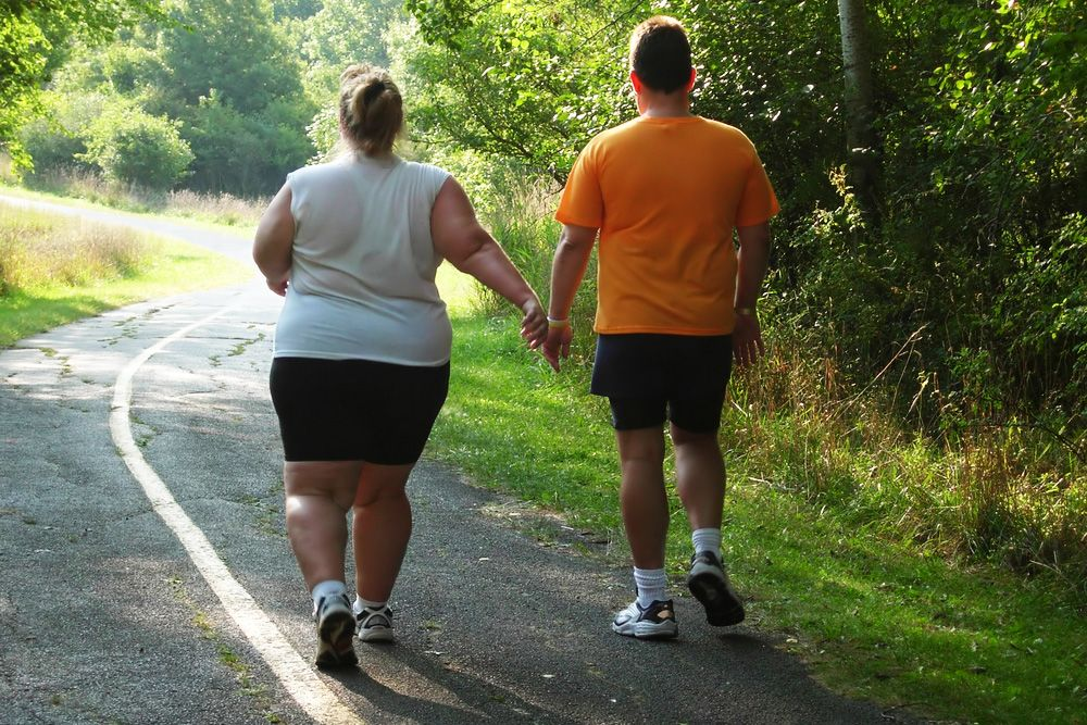 Couple walking on bike path