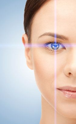 One side of woman's face with laser design over her eye
