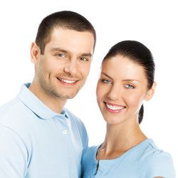 A man and woman with full, healthy smiles