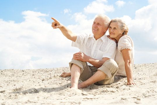 Older couple sitting on beach