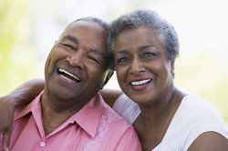 A grey-haired couple smiling together