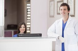 A dentist and the receptionist at a dental care center