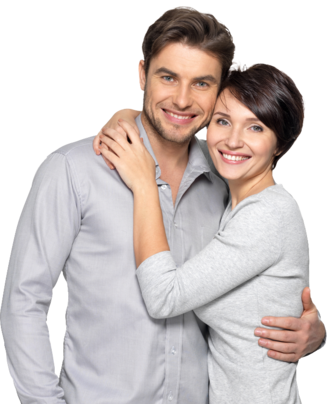 Woman hanging on man's back while smiling following their cosmetic dentistry appointments