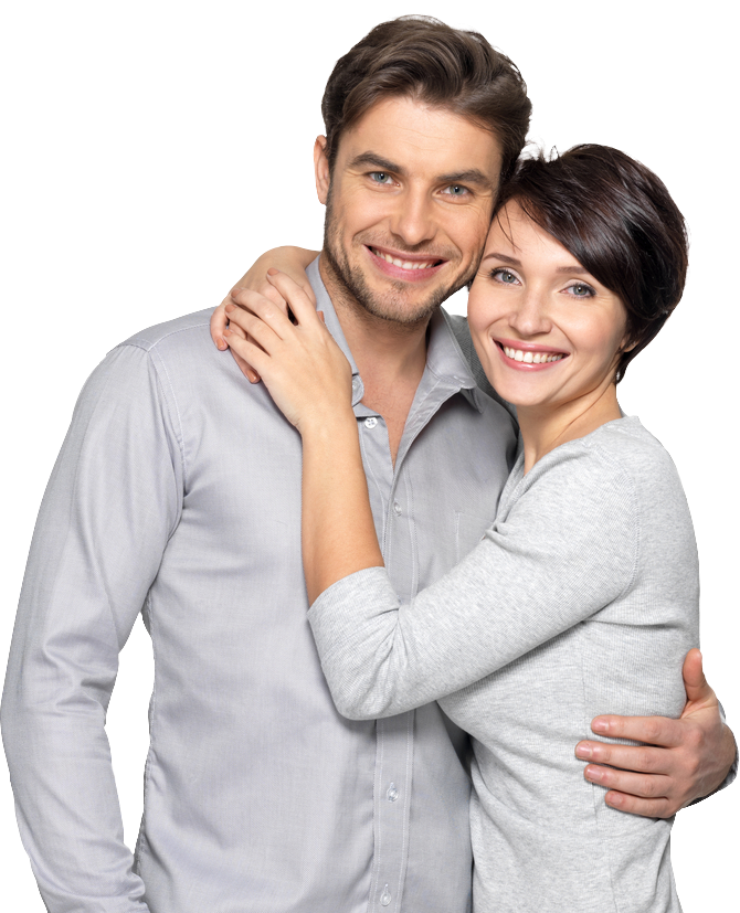 An attractive brunette man and woman hold one another in a close embrace while smiling.