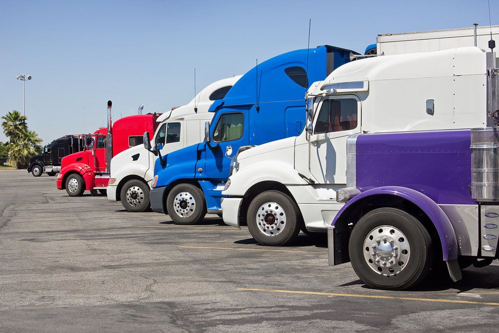 A group of large trucks