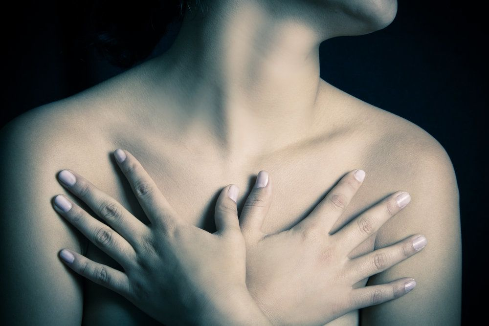 A woman holding her chest