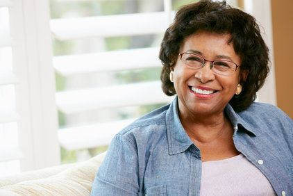 Smiling elderly woman in glasses