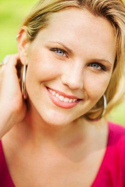 A beautiful blonde woman smiling