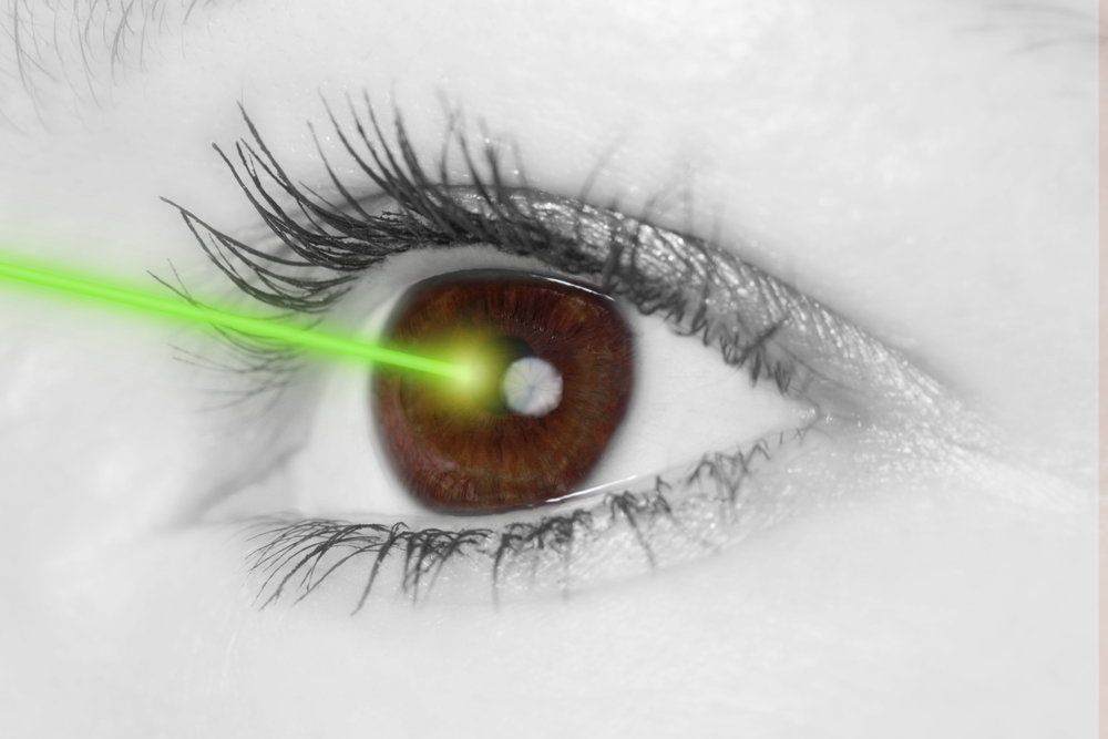 A woman's eye being treated with a laser