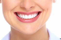 Close up of Caucasian woman's very straight, white teeth