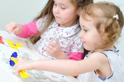 Two young girls playing with toys