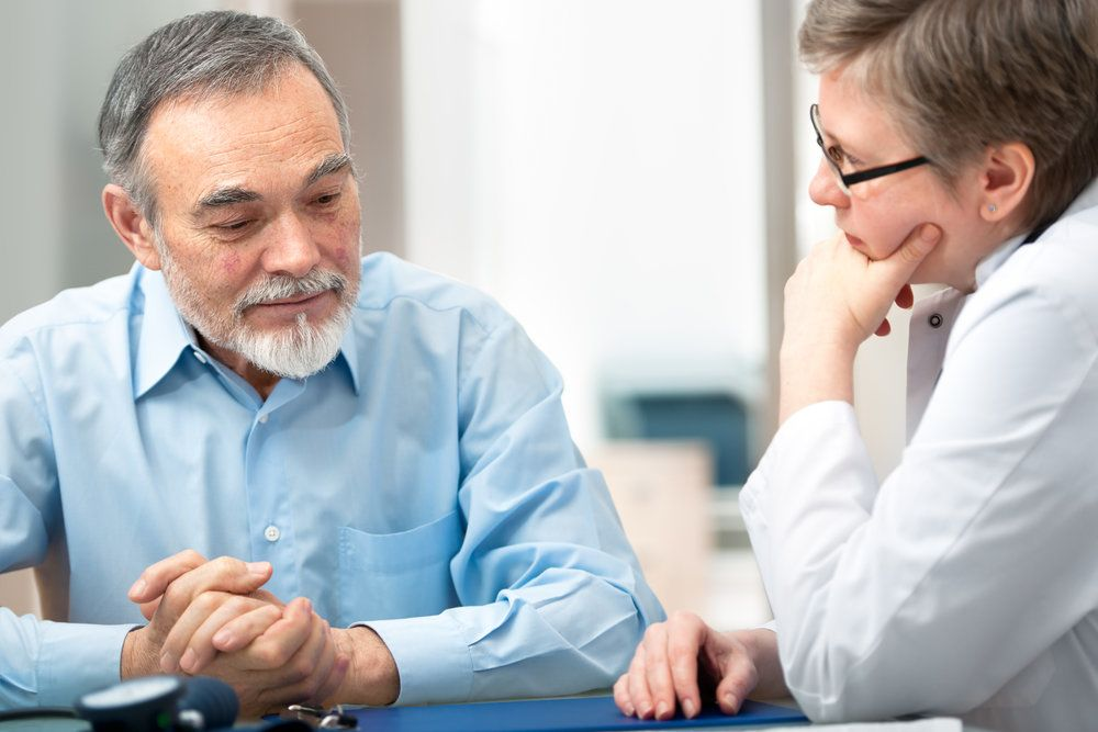 An older man consulting his doctor