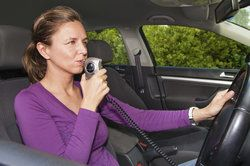 Woman using ignition interlock device