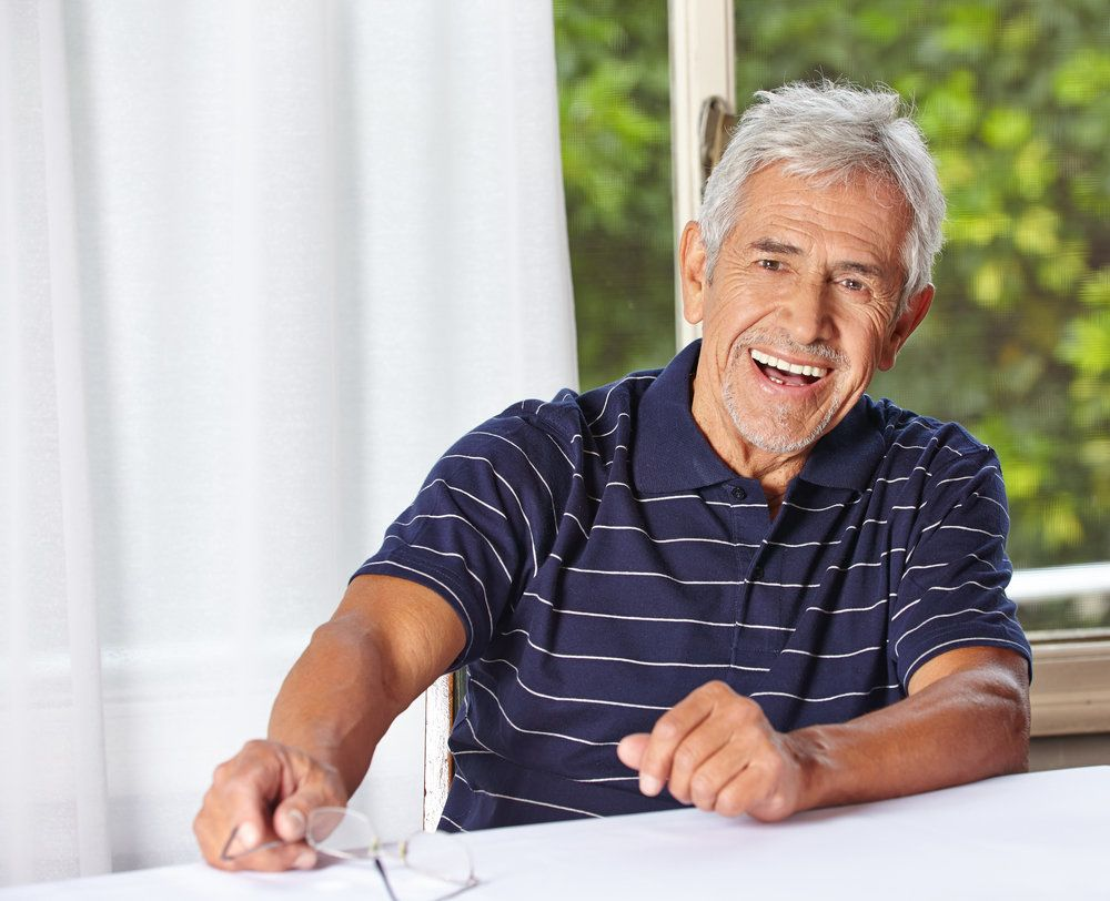 An older man with a healthy, bright white smile