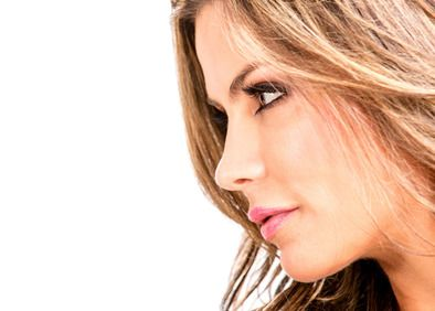 Profile view of a young woman showing her pretty nose