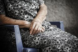 An older woman seated in a chair
