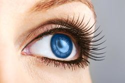 woman dark blue eye with extremely long lashes
