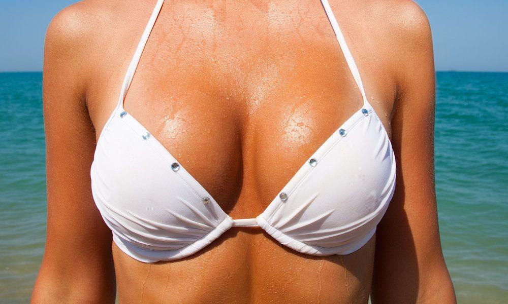 Woman in white bikini top