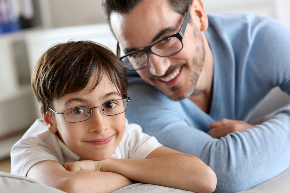 A boy and a man wearing eyeglasses