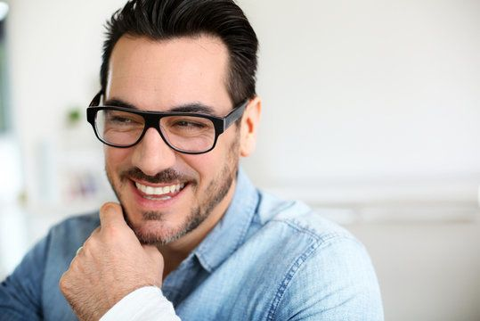 Guy with fashionable glasses frames