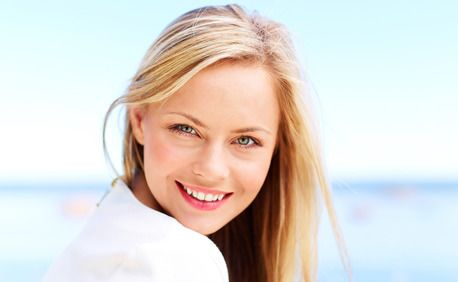 A beautiful blond girl with a healthy smile
