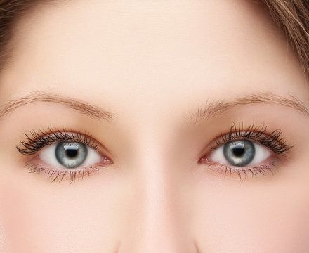 Woman's bright eyes and smooth brow area