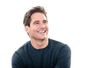 Smiling man in black shirt