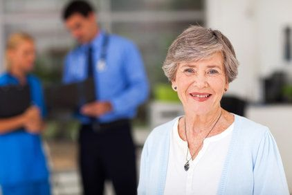 Elderly Caucasian woman with short, gray hair and blue cardigan